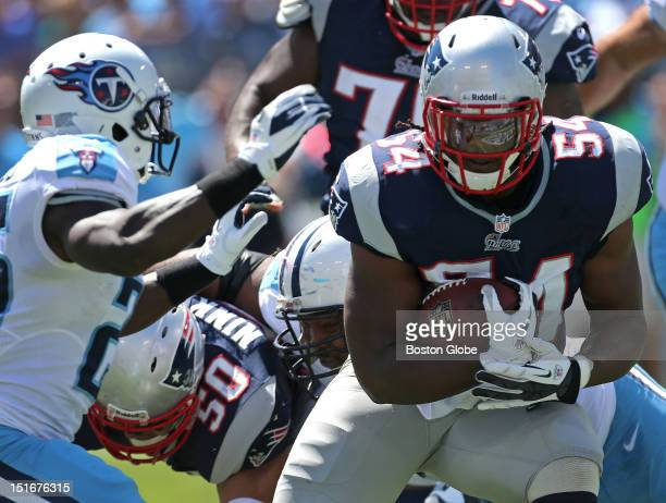 New England Patriots linebacker Dont'a Hightower protects the football as he runs for a touchdown after recovering a fumble in the second quarter of...