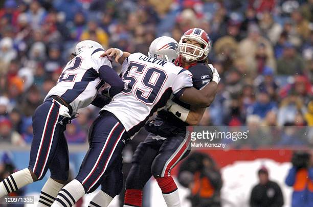 New England Patriots linebacker Rosevelt Colvin makes a hit on Buffalo Bills quarterback JP Losman after a pass in a game at Ralph Wilson Stadium in...