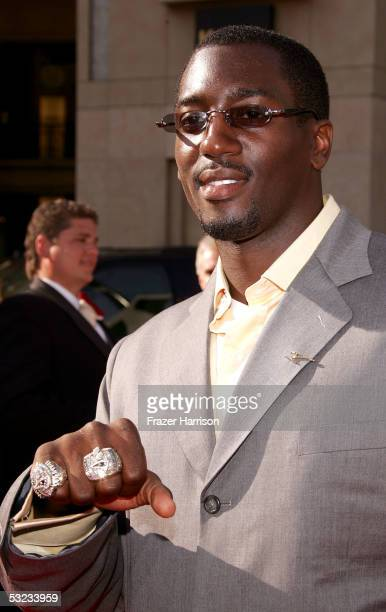 New England Patriots linebacker Rosevelt Colvin shows off his two Super Bowl rings as he arrives to the 13th Annual ESPY Awards at the Kodak Theatre...