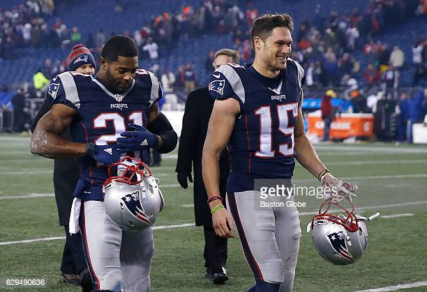 New England Patriots' Malcolm Butler left and Chris Hogan walk off the field together at the conclusion of the game New England Patriots play against...