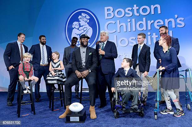New England Patriots Martellus Bennett laughs along with Jay Leno and teammates Nate Solder Sebastian Vollmer Geneo Grissom Rob Ninkovich and kids...