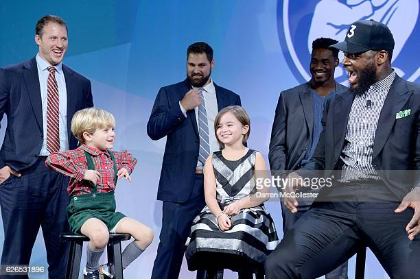 New England Patriots Martellus Bennett laughs with George and Isabel and teammates Nate Solder Sebastian Vollmer and Geneo Grissom Champions for...