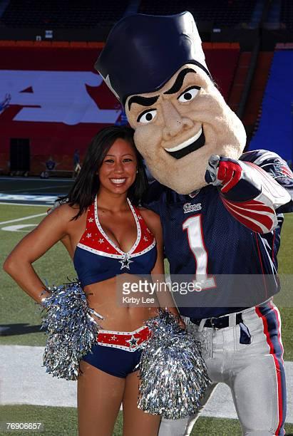 New England Patriots mascot Pat Patriot poses with Patriots cheerleader Briana Lee at NFL Pro Bowl Ohana Day Celebration at Aloha Stadium in Honolulu...