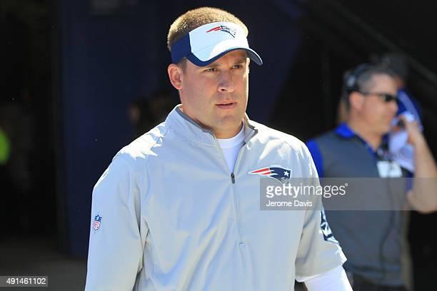 New England Patriots offensive coordinator Josh McDaniels looks on during the first half against the Buffalo Bills at Ralph Wilson Stadium on...