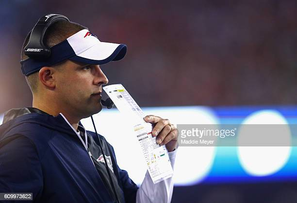 New England Patriots offensive coordinator Josh McDaniels looks on during the game against the Houston Texans at Gillette Stadium on September 22...