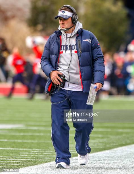 New England Patriots offensive coordinator Josh McDaniels walks the sidelines during a National Football League game between the between the Buffalo...
