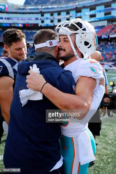 New England Patriots offensive coordinator / quarterbacks coach Josh McDaniels hugs Miami Dolphins wide receiver Danny Amendola after a game between...