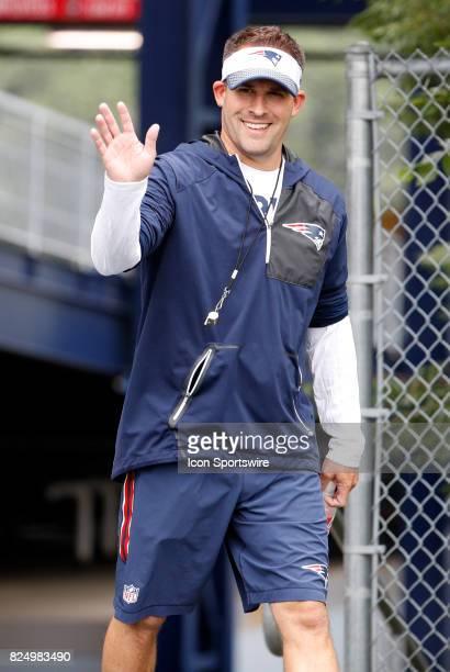 New England Patriots offensive coordinator / quarterbacks coach Josh McDaniels waves to the fans during New England Patriots training camp on July 29...