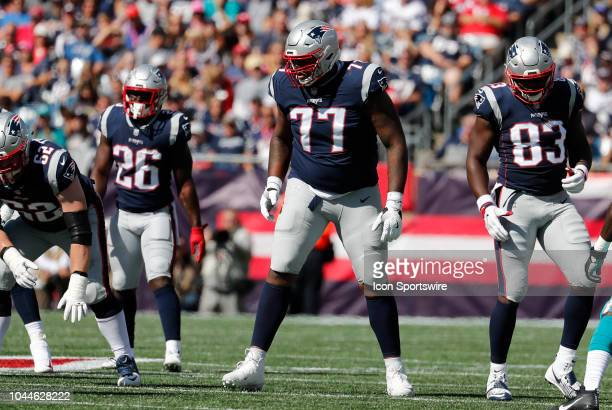 New England Patriots offensive lineman Trent Brown gets ready for a play during a game between the New England Patriots and the Miami Dolphins on...