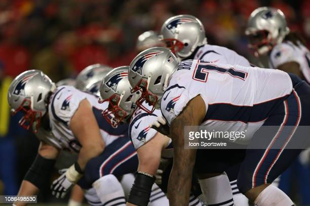 New England Patriots offensive tackle Trent Brown and the Patriots line before the snap in the fourth quarter of the AFC Championship Game game...