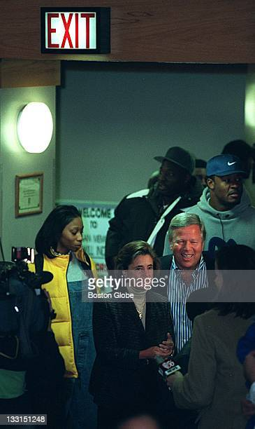 New England Patriots owner Robert Kraft and his wife Myra arrive at Morgan Memorial Goodwill Industries for a turkey giveaway but the sign hanging...