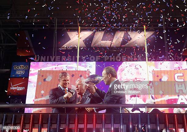 New England Patriots Owner Robert Kraft and son Jonathan Kraft celebrate with the Vince Lombardi Trophy alongside NFL Network's Dan Patrick after...