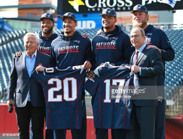 New England Patriots owner Robert Kraft far right stands with the team's four top 2017 draft choices Gillette Stadium in Foxborough Mass on May 4...