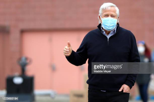 New England Patriots owner Robert Kraft gives a thumbs up to passing cars at the SoupR Bowl at Gillette Stadium on May 08 2020 in Foxborough...