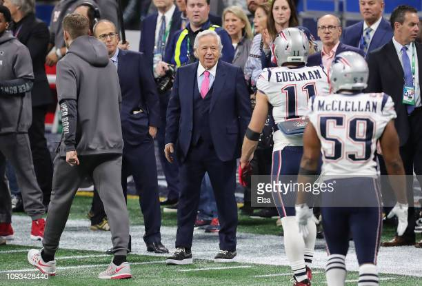 New England Patriots owner Robert Kraft greets Julian Edelman and Albert McClellan on the field prior to the start of Super Bowl LIII against the Los...