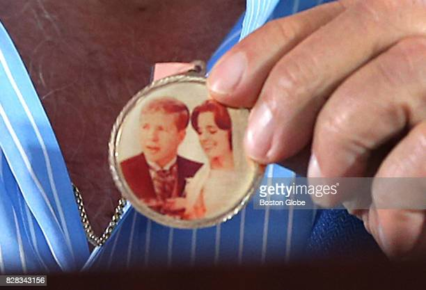 New England Patriots owner Robert Kraft holds a medal containing a wedding photo of him and his late wife Myra that was given to him former Patriot...