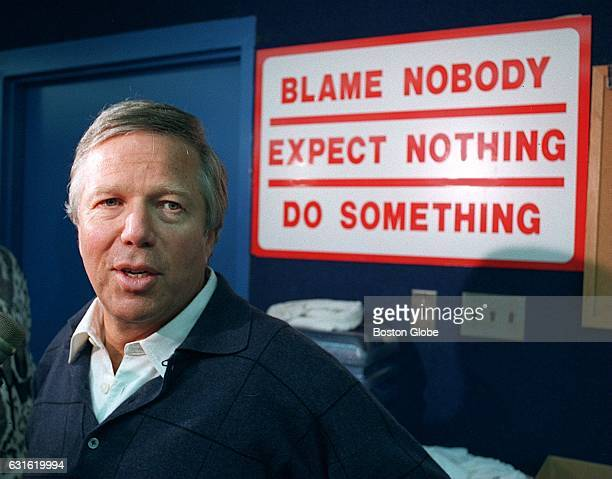 New England Patriots owner Robert Kraft passes through the Patriots locker room as the players get ready for practice with a sign of inspiration...