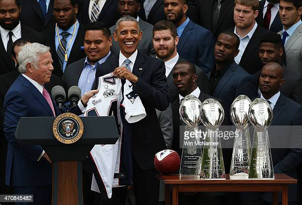 New England Patriots owner Robert Kraft presents US President Barack Obama with a Patriots jersey as Obama welcomed the National Football League...