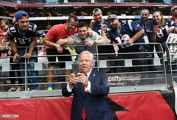 New England Patriots owner Robert Kraft takes selfies with fans before his team's NFL game against the Arizona Cardinals at University of Phoenix...