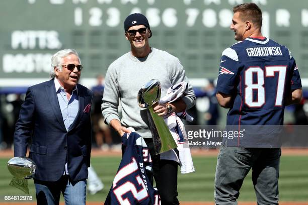 New England Patriots owner Robert Kraft talks with Tom Brady and Rob Gronkowski before the opening day game between the Boston Red Sox and the...