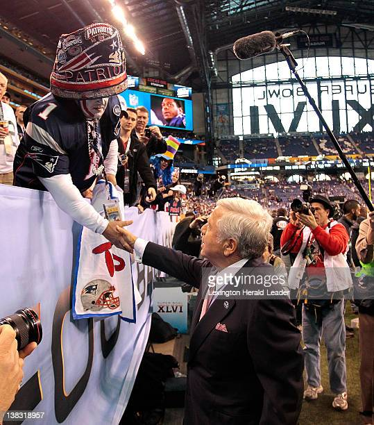 New England Patriots owner Robert Kraft thanks fan Ed Lasater for a banner that said 'Myra this year's for you' before Superbowl XLVI on Sunday...