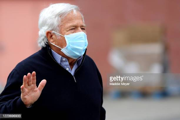 New England Patriots owner Robert Kraft waves to passing cars at the SoupR Bowl at Gillette Stadium on May 08 2020 in Foxborough Massachusetts The...