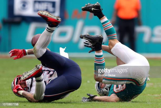 New England Patriots' Patrick Chung left and Dolphins wide receiver Danny Amendola strike similar poses as an incomplete pass eludes both of them The...