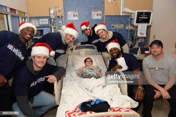 New England Patriot's Phillip Dorsett Jacob Hollister Derek Rivers Trevor Reilly Cody Hollister and Dwayne Allen visit with Luke at Boston Children's...