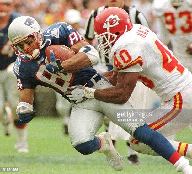 New England Patriots player 88 Terry Glen is brought down by Kansas City Chiefs defender James Hasty in third quarter action of their game at Foxboro...