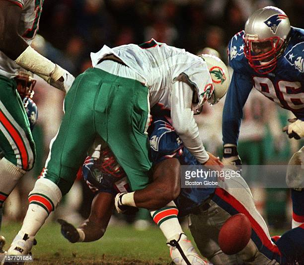 New England Patriots player De Willie McGinest slams into Mimai Dolphins quarterback Dan Marino causing a fumble that was recovered by New England