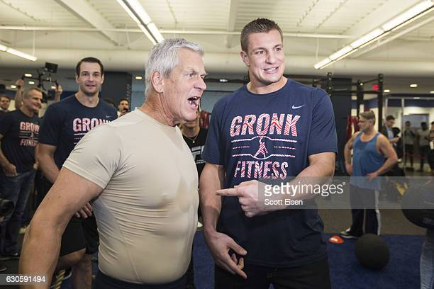New England Patriots player Rob Gronkowski right points at comedian Lenny Clarke as he arrives for the first work out in the Gronk Zone at Boston...