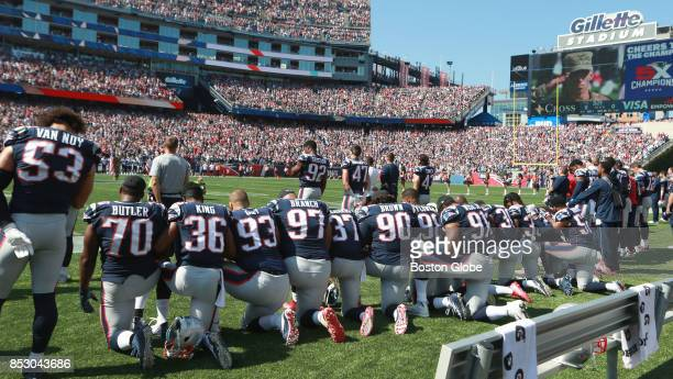 New England Patriots players take a knee during the national anthem before the start of a game against the Houston Texans at Gillette Stadium in...
