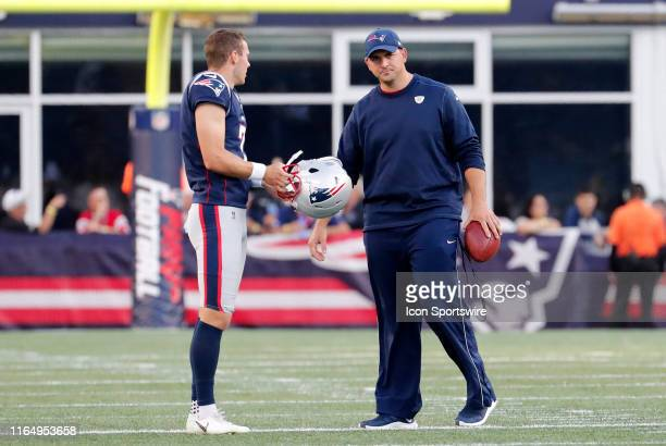 New England Patriots punter Jake Bailey and New England Patriots special teams coordinator / wide receivers coach Joe Judge before a game between the...