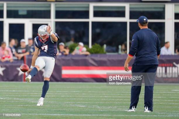 New England Patriots punter Jake Bailey warms up as New England Patriots special teams coordinator / wide receivers coach Joe Judge looks on before a...