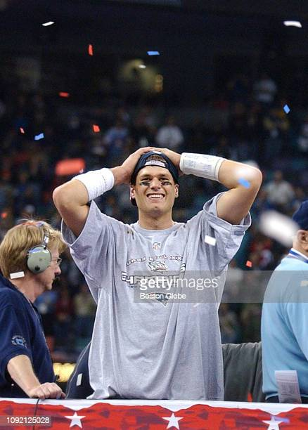 New England Patriots quarterback and Super Bowl MVP Tom Brady reacts on the podium following New England's upset victory over the St. Louis Rams in...
