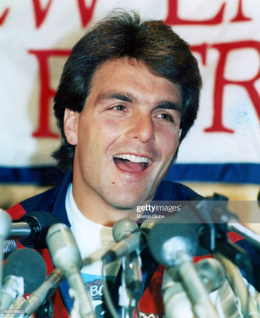 New England Patriots quarterback Doug Flutie smiles during a press conference announcing his signing with the team in Foxborough, Mass., Oct. 13, 1987.