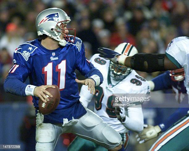 New England Patriots Quarterback Drew Bledose moves back to pass during second quarter NFL action Monday night at Foxborough Stadium against the...
