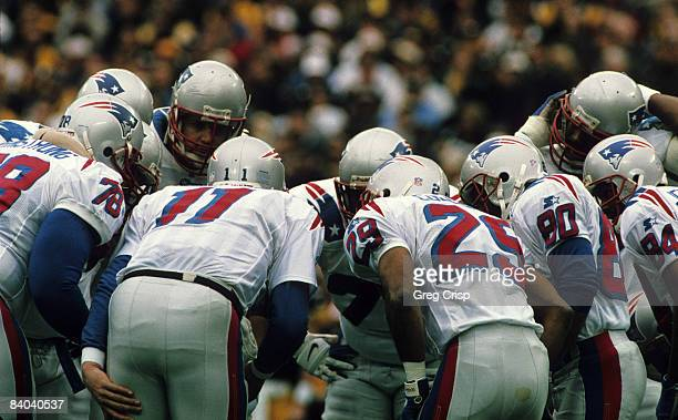New England Patriots quarterback Drew Bledsoe calls a play in the huddle during the AFC Divisional Playoff a 76 loss to the Pittsburgh Steelers on...