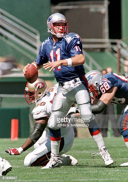 New England Patriots' quarterback Drew Bledsoe drops back to pass as Patriots' tackle Max Lane blocks San Francisco 49'ers defensive tackle Junior...