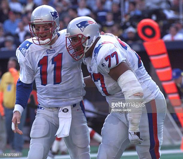 New England Patriots quarterback Drew Bledsoe is congratulated by Zefross Moss after Drew threw an 86 yard TD pass to Terry Glenn during the...