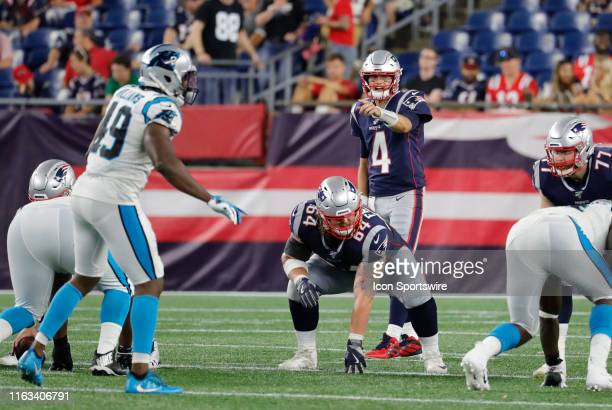 New England Patriots quarterback Jarrett Stidham points out Carolina Panthers linebacker Antwione Williams during a preseason game between the New...