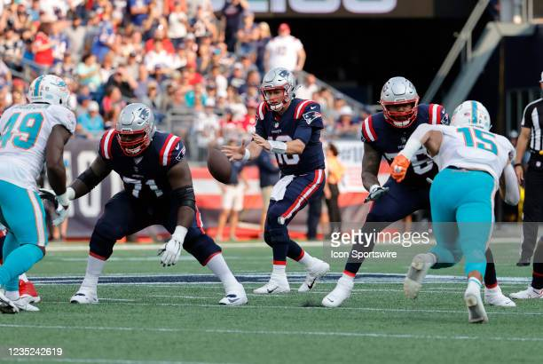 New England Patriots quarterback Mac Jones takes a snap during a game between the New England Patriots and the Miami Dolphins on September 12 at...