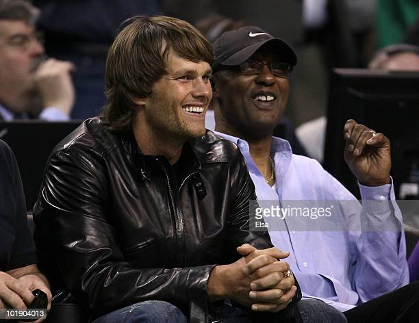 New England Patriots quarterback Tom Brady and former NBA player Joe Bryant sit courtside as the Los Angeles Lakers play against the Boston Celtics...