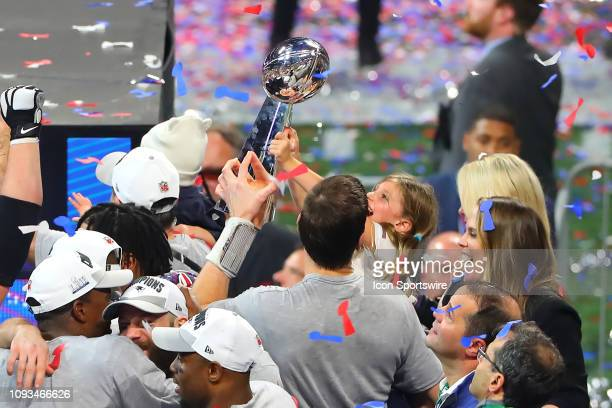 New England Patriots quarterback Tom Brady and his daughter Vivian hold the Vince Lombardi Trophy after winning Super Bowl LIII between the Los...
