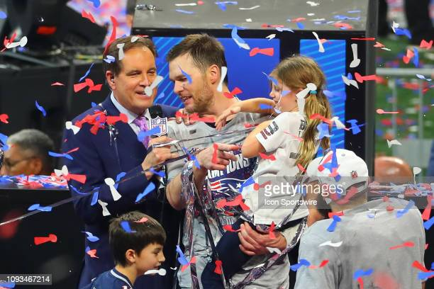New England Patriots quarterback Tom Brady and his daughter Vivian are interviewed by CBS Sports Jim Nance after winning Super Bowl LIII between the...