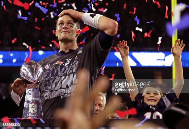 New England Patriots quarterback Tom Brady and his son celebrate with the Lombardi trophy after the Patriots defeated the Atlanta Falcons in Super...