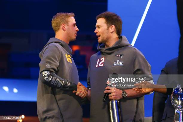 New England Patriots quarterback Tom Brady and Los Angeles Rams quarterback Jared Goff shake hands during Super Bowl Opening Night for the Los...