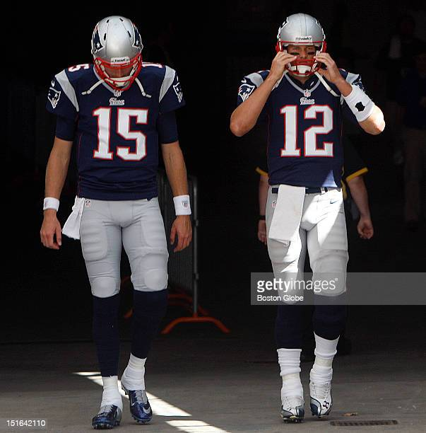 New England Patriots quarterback Tom Brady and New England Patriots quarterback Ryan Mallett take to the field for pregame warm ups before the New...