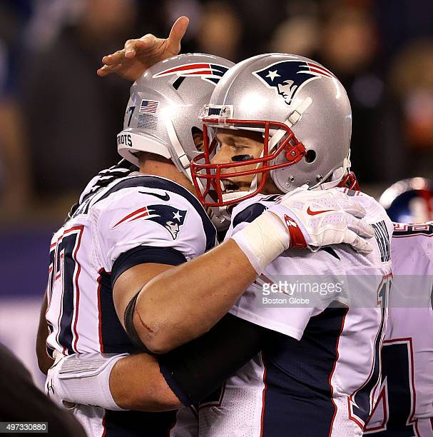 New England Patriots quarterback Tom Brady and New England Patriots tight end Rob Gronkowski embrace after the two connected for a fourth quarter...