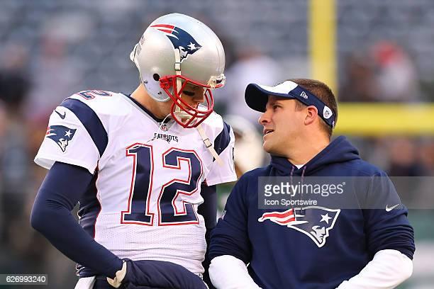 New England Patriots quarterback Tom Brady and New England Patriots offensive coordinator Josh McDaniels prior to the National Football League game...